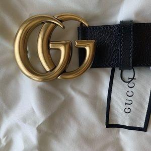 Slightly used Gold Buckle Black leather Belt